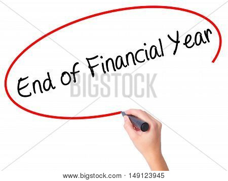 Women Hand Writing End Of Financial Year With Black Marker On Visual Screen