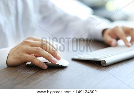 Businessman typing on keyboard in the office