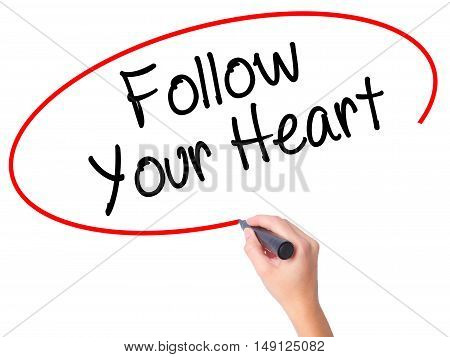 Women Hand Writing Follow Your Heart With Black Marker On Visual Screen