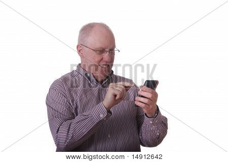 Older Bald Man In Striped Shirt Smiling Working On Smart Phone