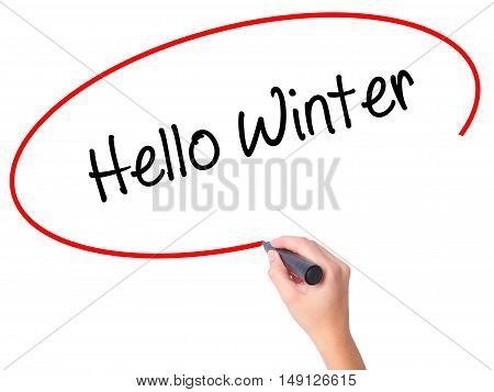 Women Hand Writing Hello Winter With Black Marker On Visual Screen