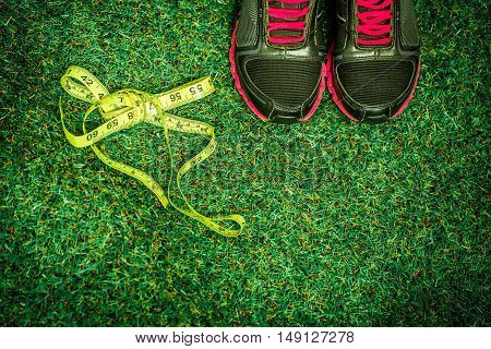 sports shoes and equipment on the background of green grass