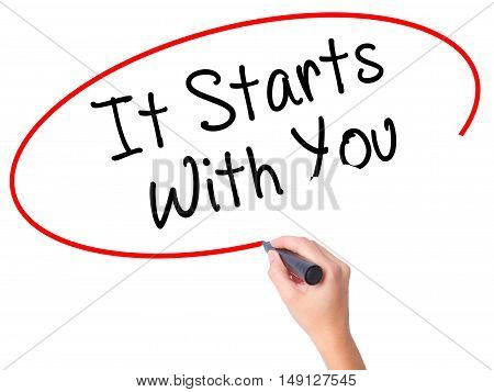 Women Hand Writing It Starts With You With Black Marker On Visual Screen