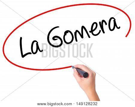 Women Hand Writing La Gomera With Black Marker On Visual Screen.