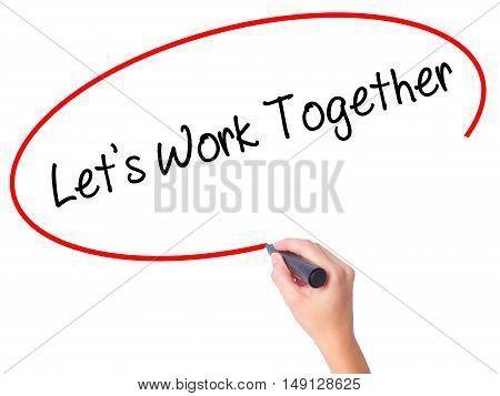 Women Hand Writing Lets Work Together With Black Marker On Visual Screen