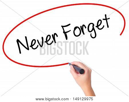 Women Hand Writing Never Forget  With Black Marker On Visual Screen
