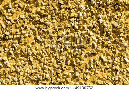 Gold stones gravel texture macro background photo
