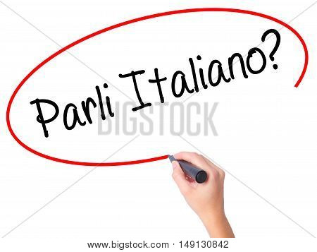 Women Hand Writing Parli Italiano? With Black Marker On Visual Screen.