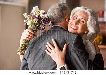 Happy anniversary Retired couple hugging each other tight while expressing love