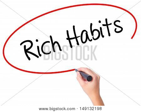 Women Hand Writing Rich Habits With Black Marker On Visual Screen