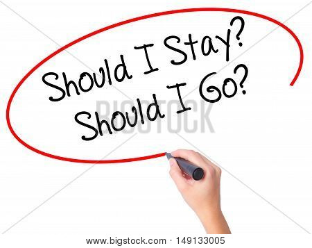 Women Hand Writing Should I Stay? Should I Go? With Black Marker On Visual Screen