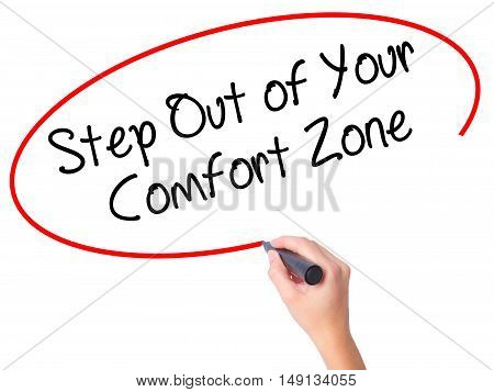 Women Hand Writing  Step Out Of Your Comfort Zone With Black Marker On Visual Screen.