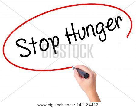 Women Hand Writing  Stop Hunger With Black Marker On Visual Screen