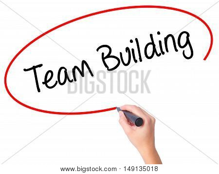 Women Hand Writing Team Building With Black Marker On Visual Screen