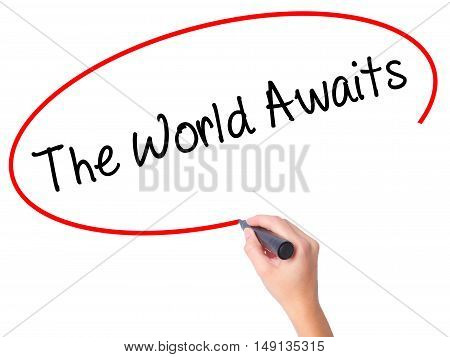 Women Hand Writing The World Awaits With Black Marker On Visual Screen