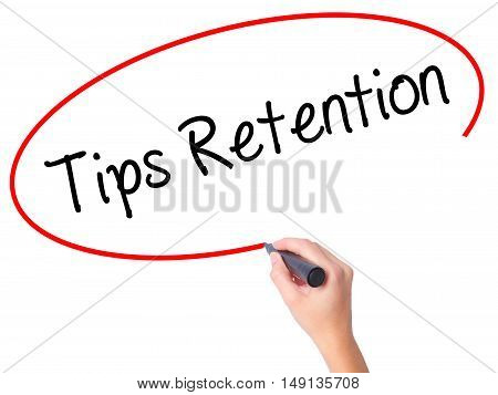 Women Hand Writing Tips Retention With Black Marker On Visual Screen.
