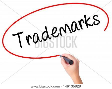 Women Hand Writing Trademarks  With Black Marker On Visual Screen