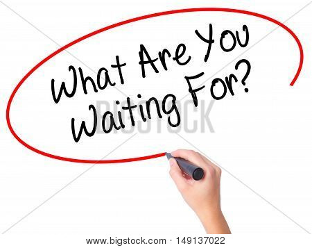 Women Hand Writing What Are You Waiting For?  With Black Marker On Visual Screen