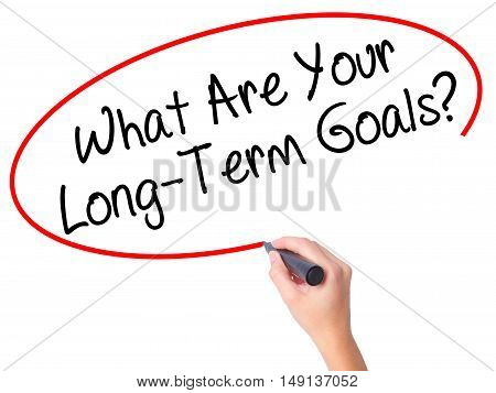 Women Hand Writing What Are Your Long-term Goals? With Black Marker On Visual Screen