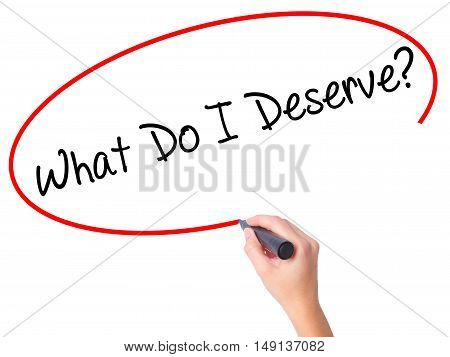 Women Hand Writing What Do I Deserve? With Black Marker On Visual Screen