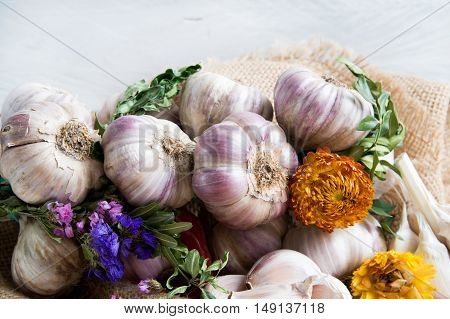 Composition of fresh garlic dried herbs and flowers