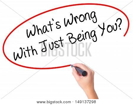 Women Hand Writing What's Wrong With Just Being You? With Black Marker On Visual Screen