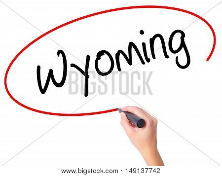 Women Hand Writing Wyoming  With Black Marker On Visual Screen