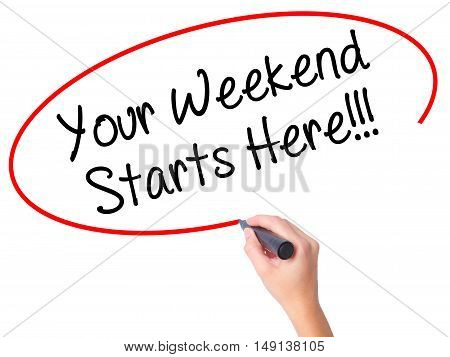 Women Hand Writing Your Weekend Starts Here!!! With Black Marker On Visual Screen