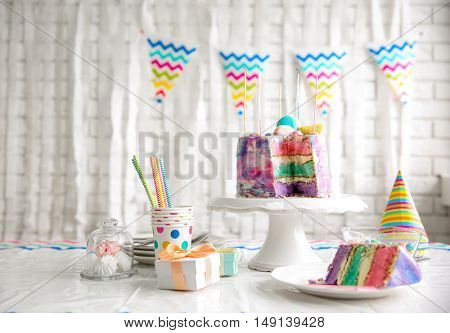 Sliced colorful cake on festive table