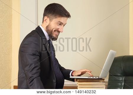 business man in office working with laptop