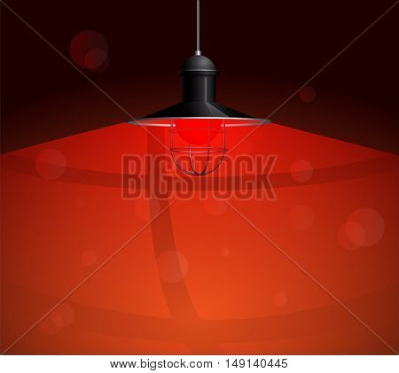 Ancient black lamp with red bulb hanging on the wire. Big and empty space illuminated on the dark red wall. Vector illustration of lighting.