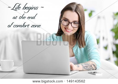 Comfort zone concept. Woman sitting at the table and working with laptop