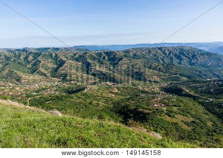 Overlooking valley hills homes rural countryside landscape