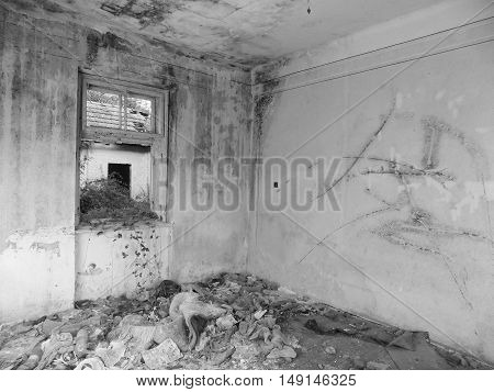 Old abandoned house interior in black and white colors