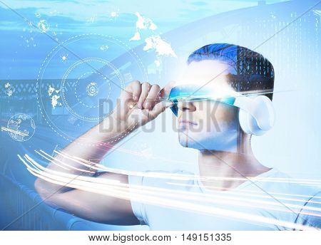 Technologies of the future concept. Man with futuristic glasses