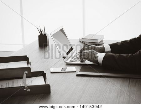 Hands of lawyer working with laptop in office. Retro style