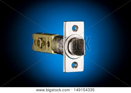 Latch mechanism isolated on blue and black background