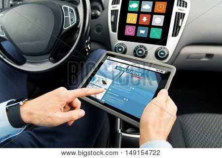 transport, business trip, technology and people concept - close up of male hands holding tablet pc computer with internet news application on screen in car