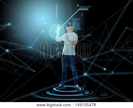 3d technology, virtual reality, entertainment, cyberspace and people concept - happy young man with virtual reality headset or 3d glasses and projection over dark background