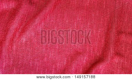 Red knit fabric textile. Abstract cloth texture background.