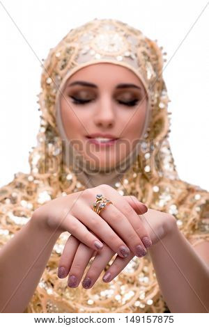 Young muslim woman with rings on white