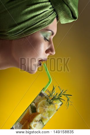 Woman In Green Turban With Cocktail