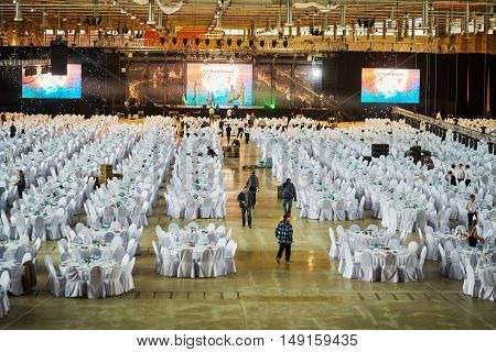 MOSCOW, RUSSIA - DEC 20, 2014: Large hall with served tables and stage during preparing to New Year Show at VDNKH exhibition.