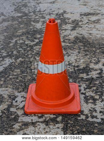 Orange traffic cones placed on the concrete floor.