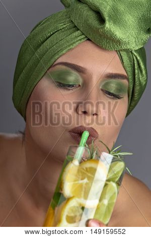 Woman In A Green Turban With Cocktail