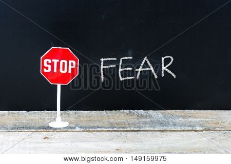 Stop Fear Message Written On Chalkboard