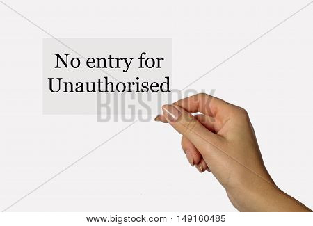 Beautiful hand of a young girl holding a card on a white background with an inscription no entry for unauthorized