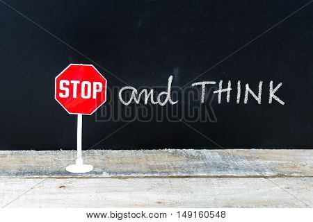 Stop And Think Message Written On Chalkboard