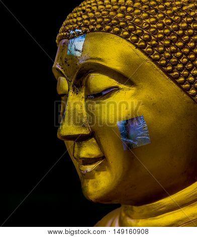 gold buddha face. Isolate on black background