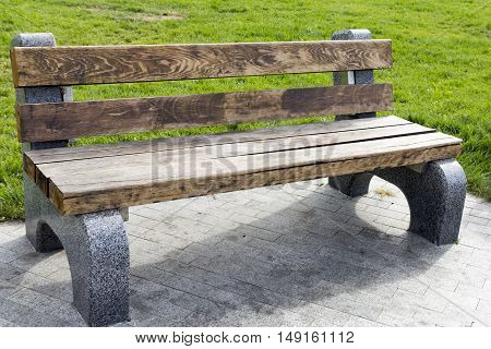 Free bench in a park on the waterfront
